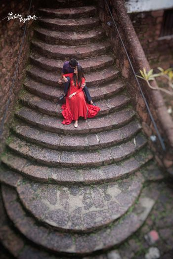 Top shot pre wedding shoot with couple on staircase