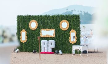 photo booth ideas with green grass backdrop and gold enamelled mirrors and RP Initials