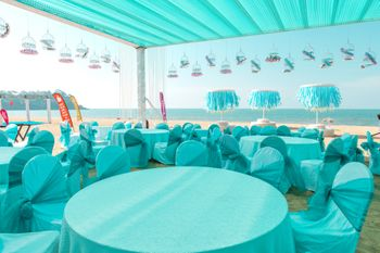 Photo of turquoise beach wedding table settings