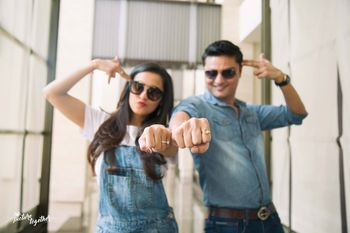 Coordinated clothes for pre wedding shoot showing rings
