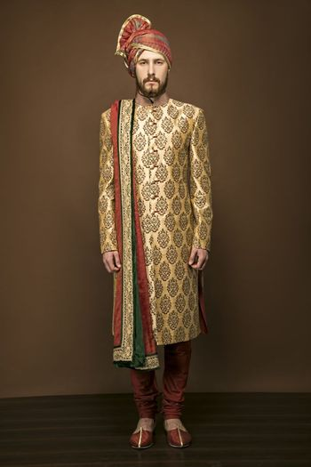 Photo of Gold and maroon sherwani with large motifs