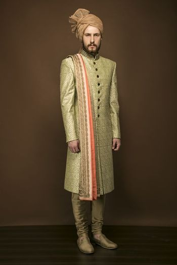 Photo of Light green sherwani with orange dupatta