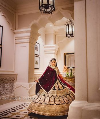 maroon and gold bridal lehenga with velvet dupatta