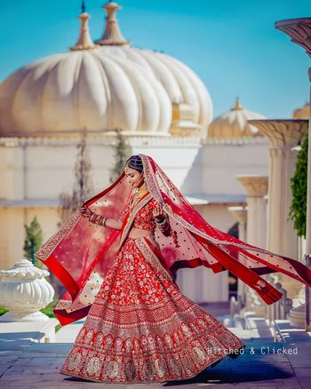 Photo of gold and red bridal lehenga with floral motifs