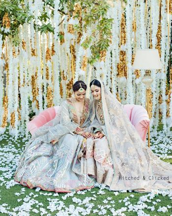 Photo of pretty bride with her sister with both wearing pastels