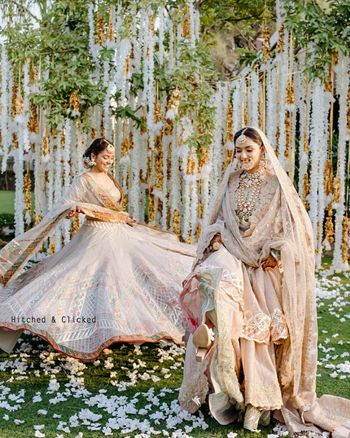 twirling bride with her sister in pastels