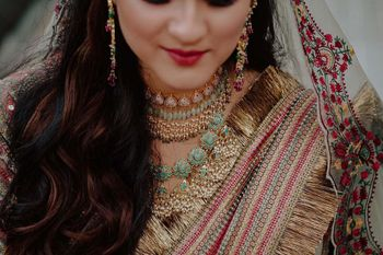 Bride wearing a choker with an enameled necklace.