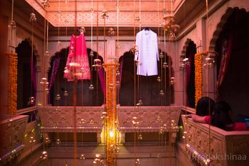 Bride and groom outfits on hanger