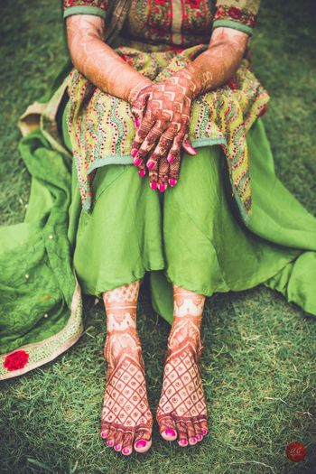 Modern mehendi design with jali on hands and feet