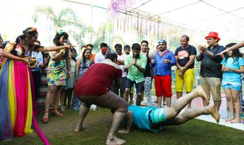 Guests playing kabaddi on mehendi