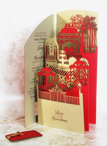 Photo of Red and gold laser cut layered wedding card
