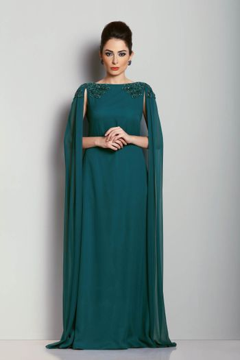 Teal evening gown with shoulder embroidered cape
