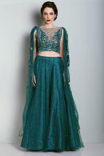 Teal light lehenga with shoulder embroidered cape