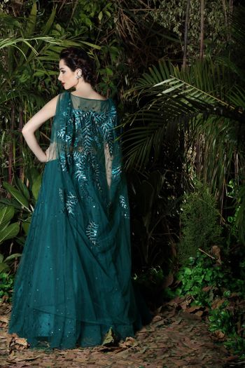 Teal evening gown with embroidered cape