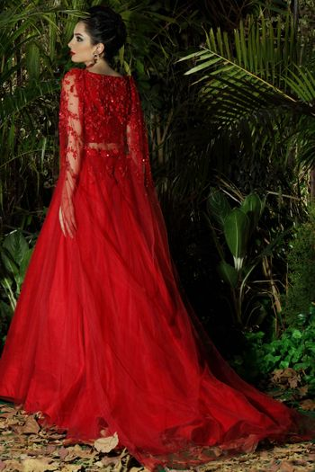 Bright red modern lehenga with net cape and train