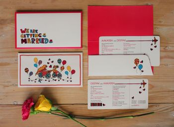 Red and white boarding pass wedding card