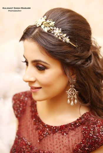 Photo of Bride wearing tiara style hair accessory with gown