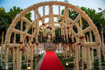 Photo of White floral frame entrance decor for wedding