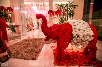 Red and white floral elephant decor