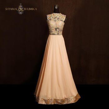 Photo of soft peach floor length sleeveless gown with high neck