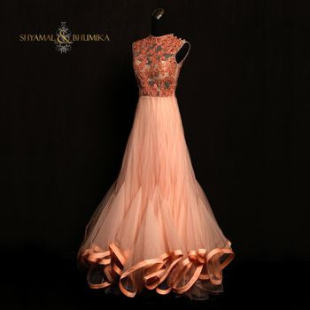 Photo of sleeveless peach and orange gown in net toulle with ruffles and satin lining