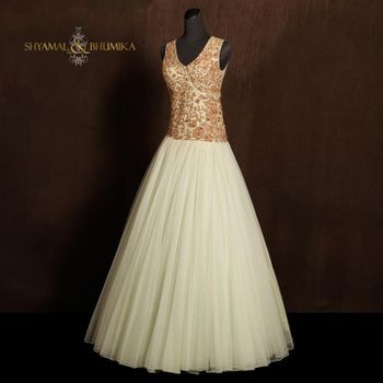 Photo of floor length engagement gown v neck sleeveless with eggshell color in white cream and gold