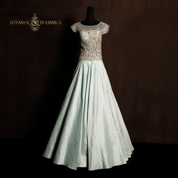 Photo of ice blue satin floow length half sleeves gown in metallic ice grey color
