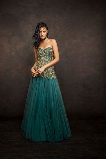Photo of teal blue floor length gown with toulle