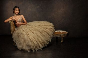 Photo of gold light lehenga with poofy lace and feather and bustier metallic blouse with dupatta