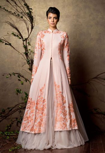 Photo of peach jacket style lehenga