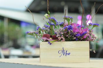Photo of Wooden crate floral arrangement as centerpiece