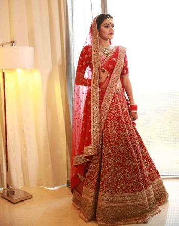 Red and gold bridal lehenga with sequin work