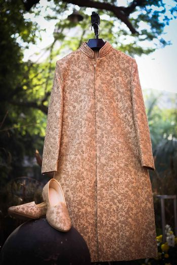Dusty pink sherwani with gold embroidery and matching juttis