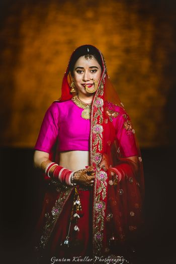 55903616fc Photo of twirling bride shot in peach and gold anarkali