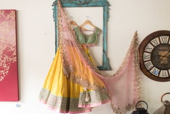 Photo of butter yellow lehenga with pink dupatta