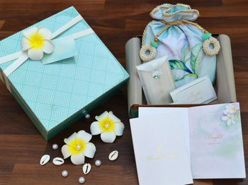 Photo of Elegant turquoise wedding invite box with potlis for favors