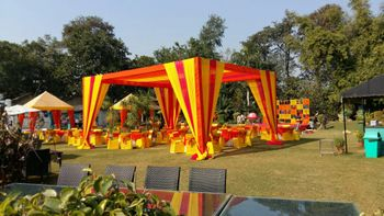 yellow and orange tents mehendi decor