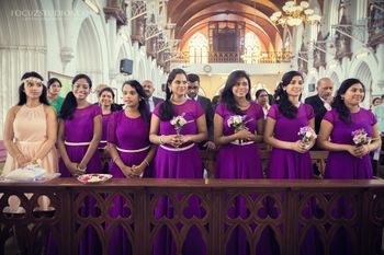 color co-ordinated bridesmaids wearing purple gowns