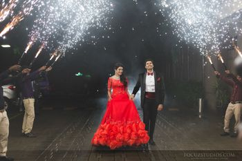 bride and groom engagement entry with sparklers
