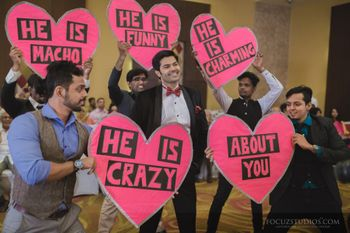 grooms men holding cute signage boards