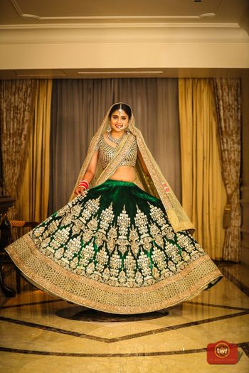 Twirling bride in shades of green