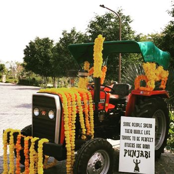 punjabi wedding decor with truck and funky signage board