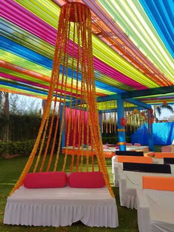 Photo of genda floral strings stage decor for mehendi