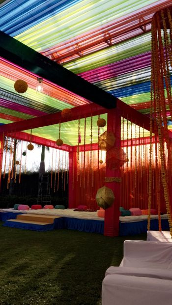 cute colorful mehendi hanging floral strings and umbrellas decor