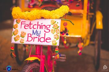 Mehendi decor idea with decorated rickshaw and quote