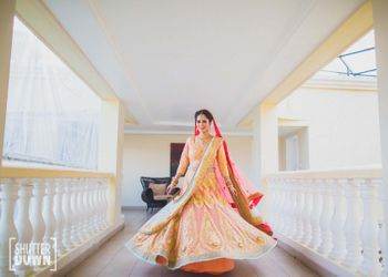 twirling bride shot in peach and gold lehenga
