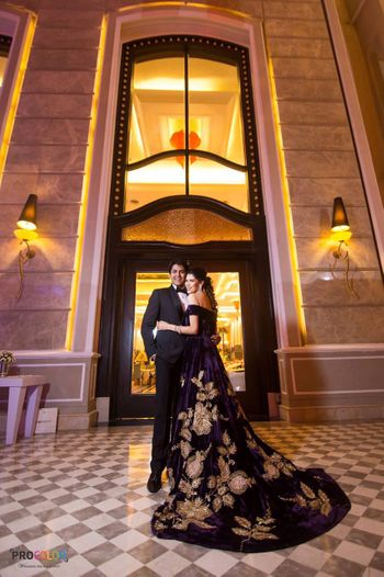 purple and gold motifs gown