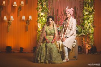 Photo of Contrasting bride and groom outfits in post wedding shoot