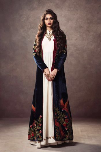 Photo of royal blue velvet jacket with off white anarkali