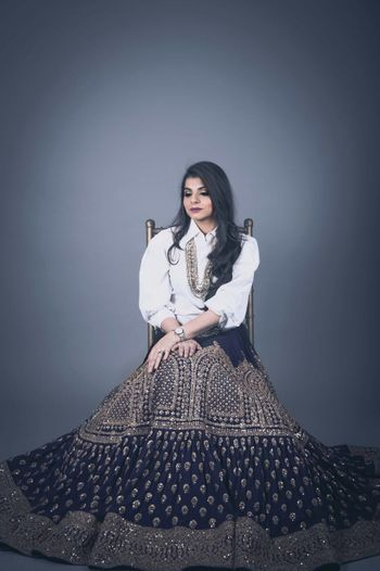 Photo of off beat ethnic fusion black and gold lehenga